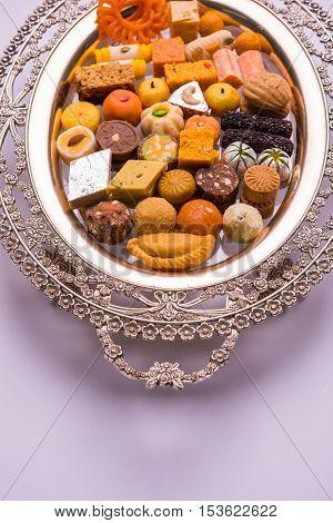 Mix Mithai or indian milk made sweets, favourite diwali, holi, dussehra, indian or pakistani wedding sweet food poster
