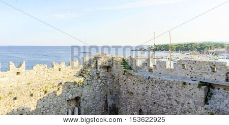 The interior of the Frankopan Castle at Kamplin square in Krk Croatia - Frankopanski Kastel part of the medieval city walls. View of the archer loop holes and sea port of the island