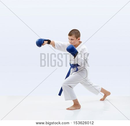 Karateka with overlays on the hand is beating punch arm