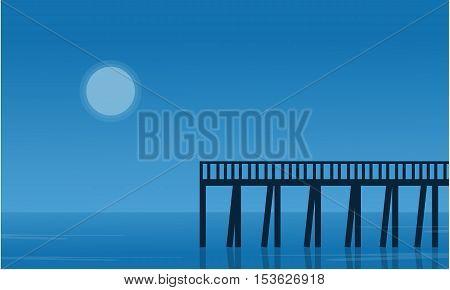 Silhouette of pier on seaside scenery vector