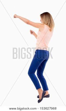 skinny woman funny fights waving his arms and legs. Isolated over white background. The blonde in a pink shirt boxing