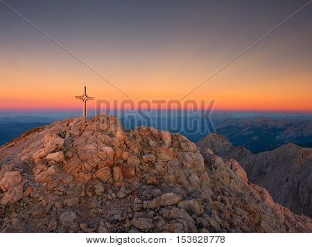 Peak Of Hoher Goell. Iron Cross At Mountain Top In Alp At Austria Germany Border.