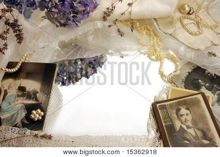 Vintage background with photographs, dried flowers and pearls