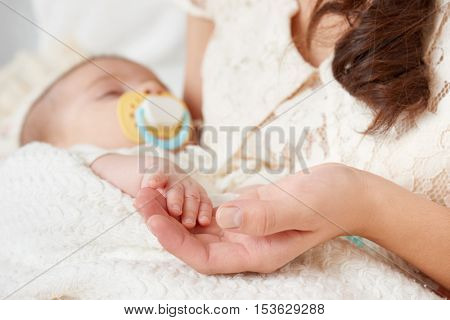 baby sleep in mother hand, happy maternity concept