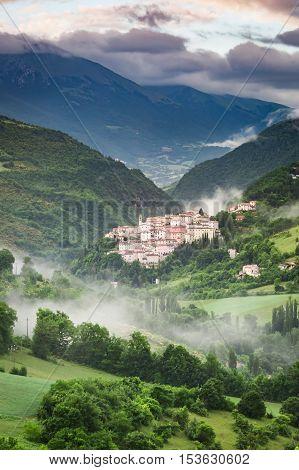 Beautiful Foggy Sunrise Over The Village Of Preci In Umbria, Italy