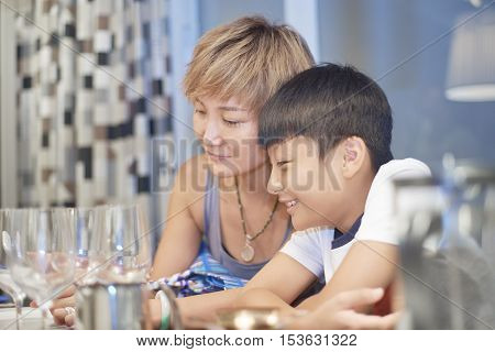 Young Mother And Son In Dining Room Enjoying