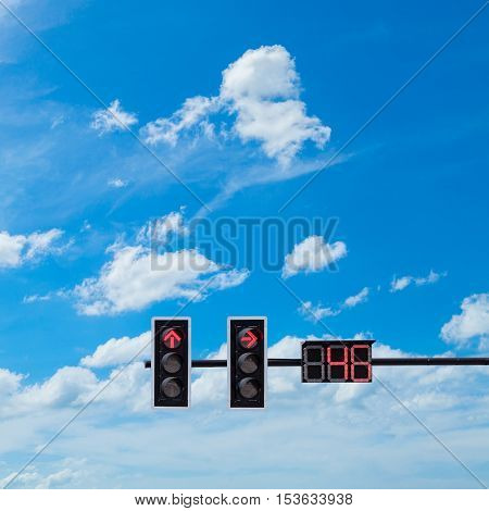 traffic light with red light on blue sky background