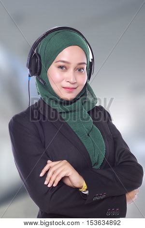 Young Muslim Women On Blur Background