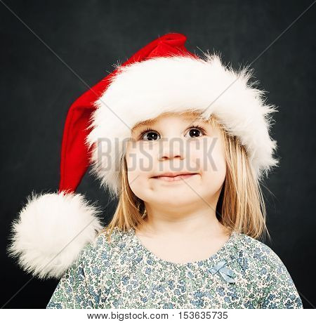 Christmas Child. Happy Child in Santa Hat Smiling