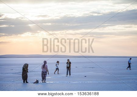 Lake Tuz Turkey - September 25 2016: Color image of people walking on Tuz salt lake in Turkey. Lake Tuz (Tuz Golu) is one of the largest hypersaline lakes in the world.