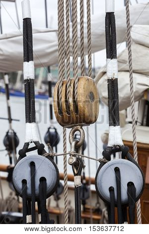 Old wooden pulley on a sailing boat in harbor
