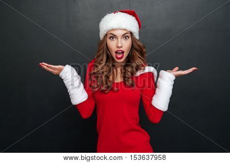 Interrogative christmas woman looking at the camera