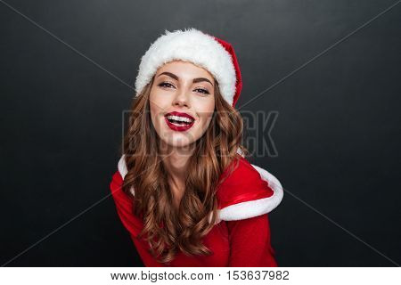 Smiling santa's helper over black background. Close up