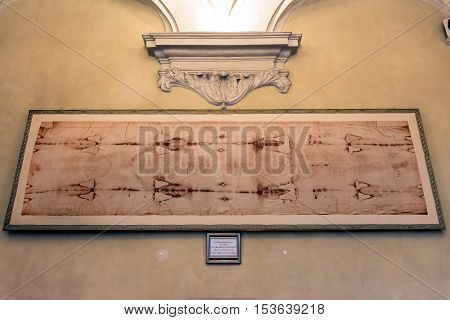 Turin, Italy - December 31, 2015: Royal Church of San Lorenzo interior with a copy of the holy Shroud in Turin Italy. The Sacra sindone is believed to be the burial shroud of Jesus of Nazareth.