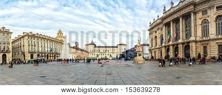 Turin, Italy - December 31, 2015: tourists visit Piazza San Carlo in Turin Italy. It was laid out in the 16th and 17th century and is an example of Baroque style.