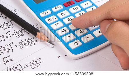 Hand Press Calculator On Mathematical Or Math Equations. Math Homework Or Math Exams. Solving Mathem