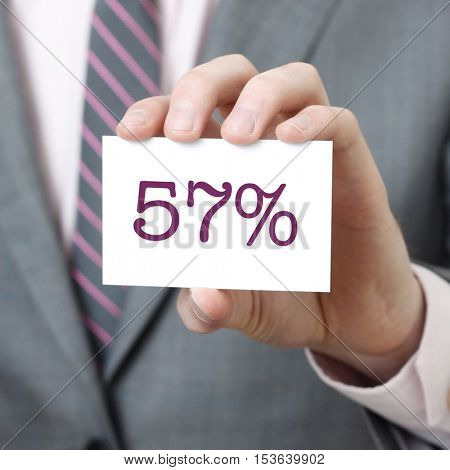 57% written on a card held by a businessman