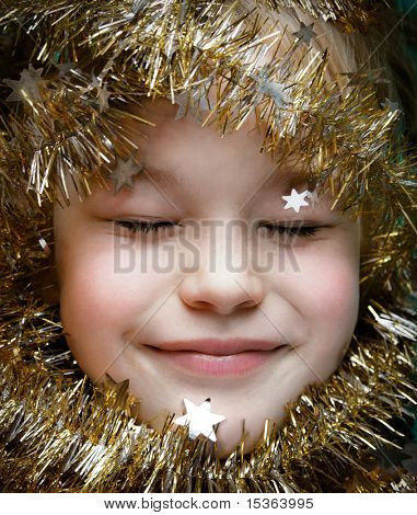 Christmas dream - close up of cute happy child