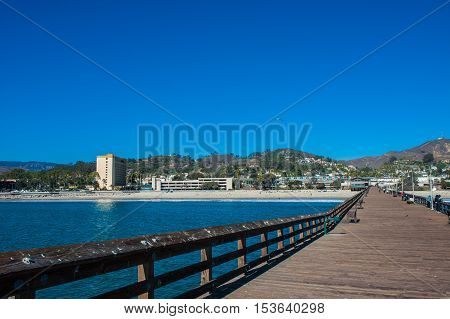 Wooden planks and vacation hotel as viewed from the Ventura Pier.