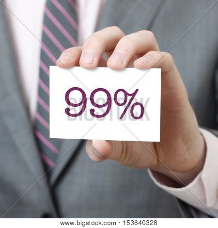 99% written on a card held by a businessman