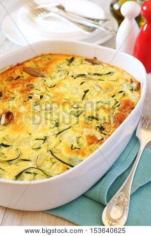 Vegetable marrow squash gratin with cheese and shallot in ceramic bakeware