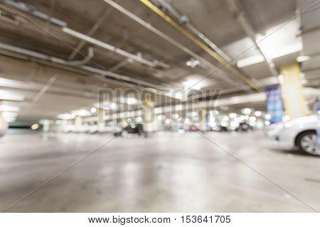 Blurred image Parking garage interior underground parking with cars.