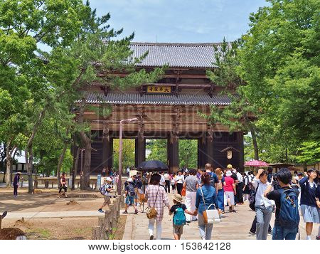 Nara, Japan - June 06, 2016: Unidentified people in front of Nandaimon Gate, part of Todaiji Temple, is a list of UNESCO World Heritage Site and forms part of the