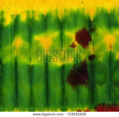 Tie dye pattern abstract background. Green and yellow.