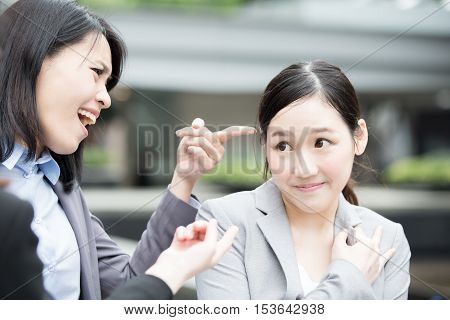 business woman bullying in hong kong office asian