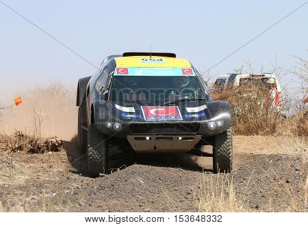 Front View Close-up Of Black Cr-2 Rally Car Going Down Slope