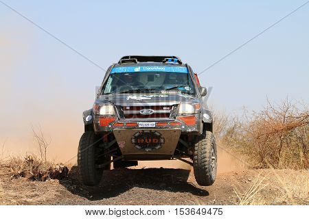 Front View Close-up Of Black Ford Ranger Rally Car Ramping Down Slope
