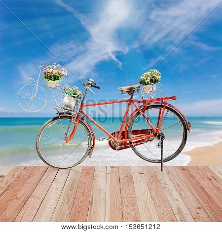 Old bicycle on wood and beautiful tropical sea background