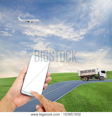 hand hold and touch screen smart phone with airplane in the sky dumper truck on road blue sky backgroundopen high season travel and tour concept