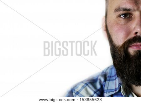 close-up portrait of a handsome bearded man posing on camera