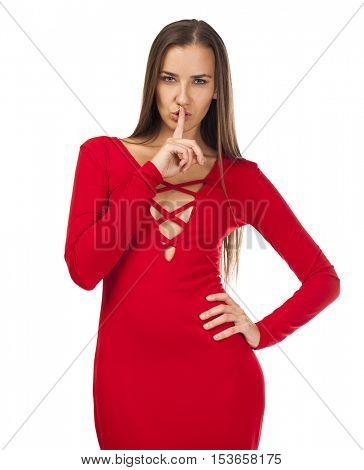 Young beautiful brunette woman has put forefinger to lips as sign of silence, isolated on white background