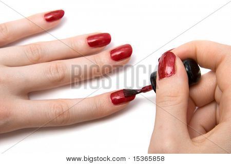 Color red nails close view. On white.
