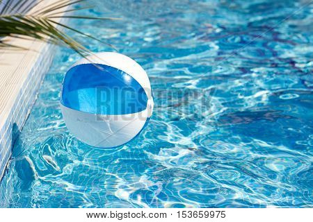 Blow up beach ball in the pool