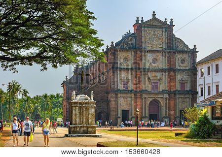 Old Goa, India - November 13, 2012: Unidentified tourists visit to the famous landmark - Basilica of Bom Jesus or Borea Jezuchi Bajilika in Old Goa India. Basilica is a UNESCO World Heritage Site.