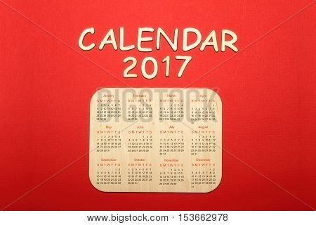 On a red background Calendar for 2017.