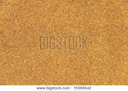 Dark cork texture or background.
