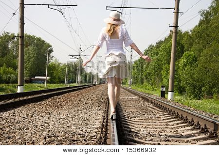 Girl going forward on a railway. poster