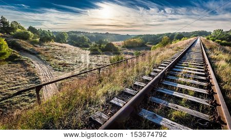 Old Railway Line In The Frosty Morning Over The Forest