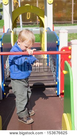 Boy in the Playground on Sunny summer day