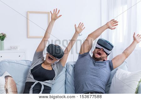 Man And Woman Wearing Vr Glasses At Home