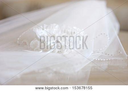 Beautiful wedding veil and a garter on wedding day