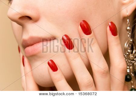 Elegant fingers on woman face.