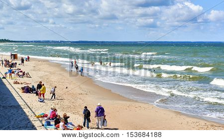 Zelenograd Russia - July 16 2016: Crowd of people on a beach of Zelenograd. Curonian spit Kaliningrad region. Russia