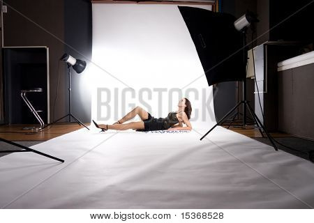 At photo studio. Making photo on white.