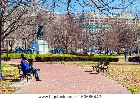 Washington Dc, Usa - January 27, 2006: Man Talking On Phone In Park In Front Of The Monument Of Jack