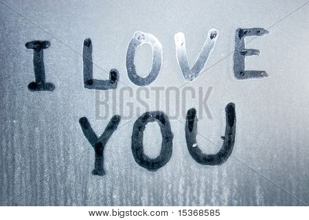 I love you text on frozen glass.